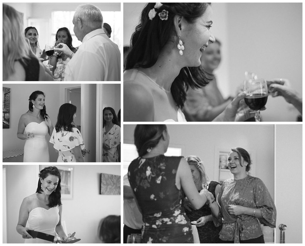 bride-is-getting-ready-at-home-with-parent-and-girlfriends-photo