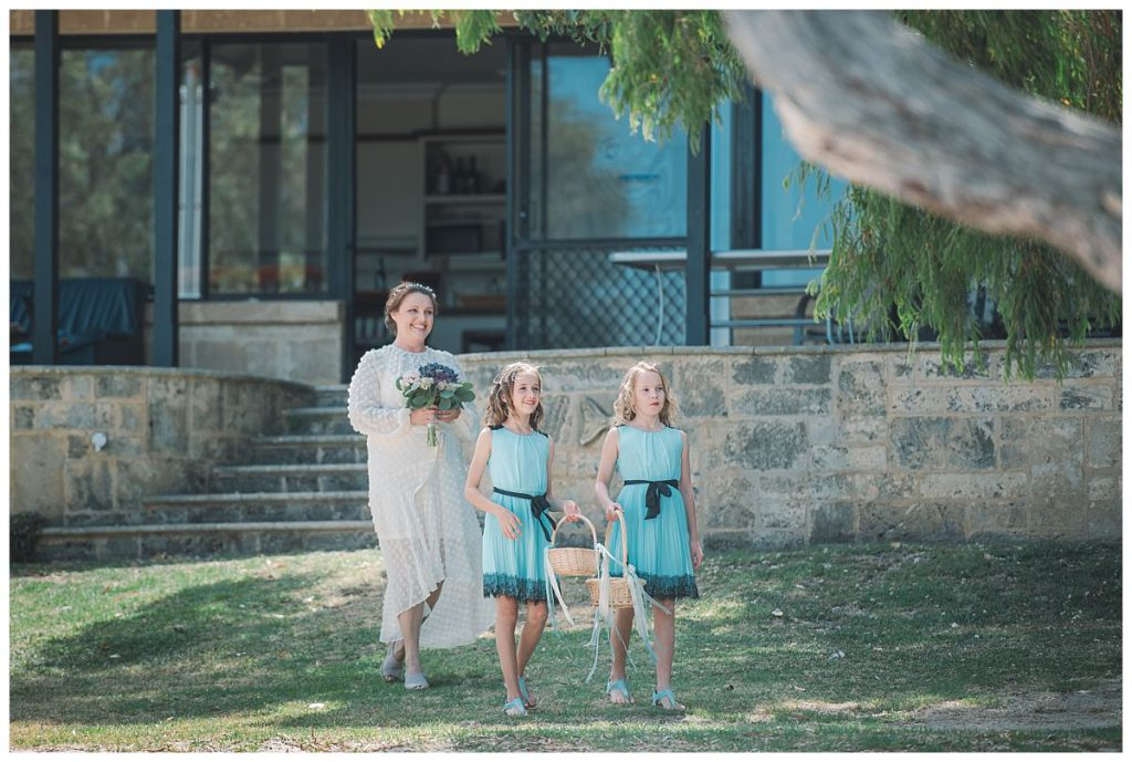 bride-to-be-walks-with-flower-girls-wedding-photo