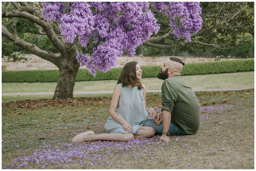 gorgeous-couple-in-jacaranda-flowers-photo