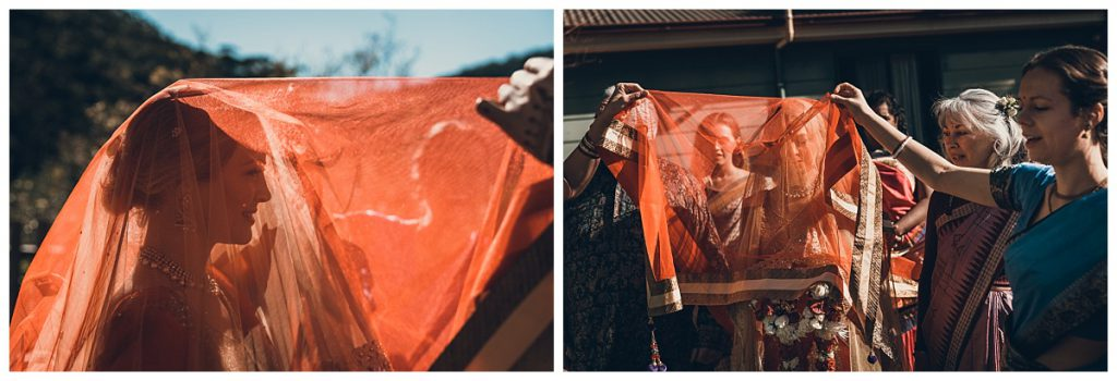 bride-covered-with-red-silk-sari-photo