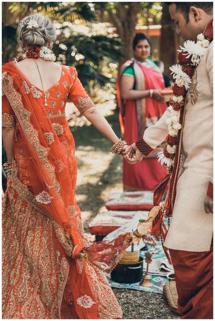 groom-follows-the-bride-indian-marriage-ceremony-photo