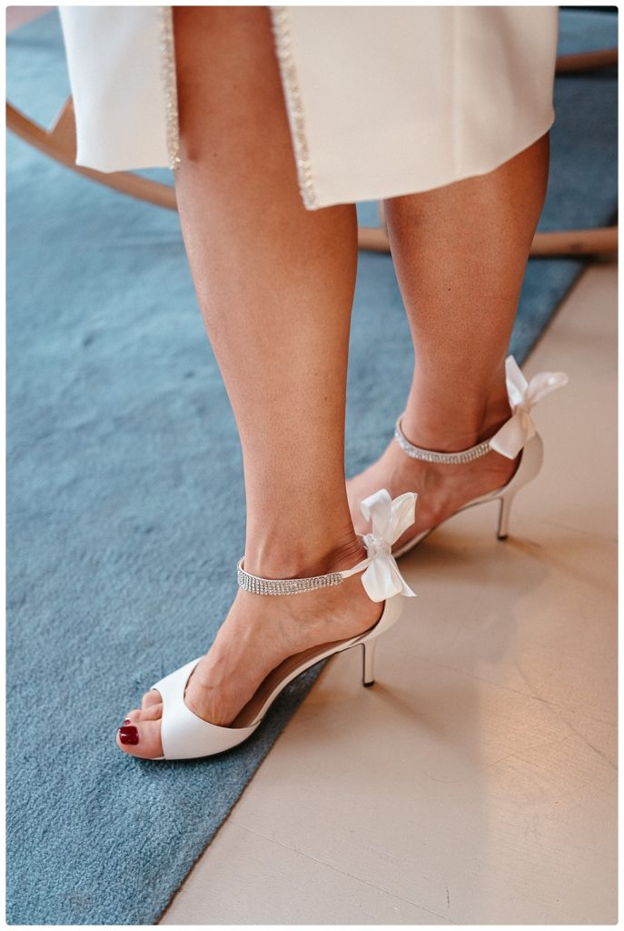 white-bridal-shoes-wedding-photo