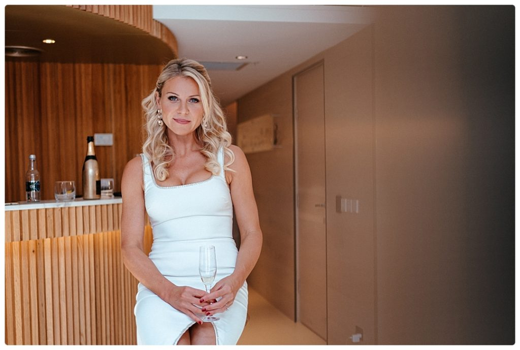 bride drinks shampagne in olovo hotel room in sydney