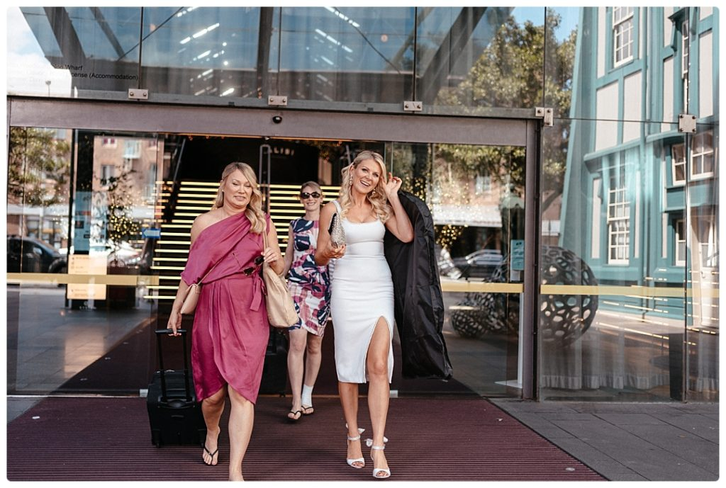 candid photo brides going to olovo hotel sydney